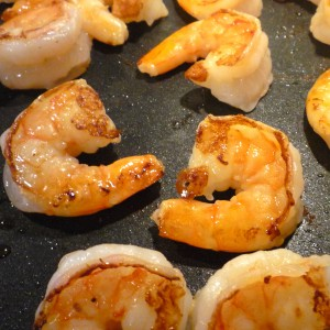 After removing the fish, add your salted/peppered shrimp.  Cook ~3 minutes per side or until they turn opaque.