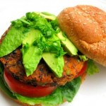 vegan black bean burger topped with avocados