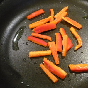 Drizzle olive oil in your medium hot non-stick pan. Add red pepper and cook for ~ 3 minutes.