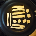 Spread your tofu out in a large non-stick pan over low heat. DO NOT use any oil.