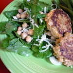 Salmon Burgers over spinach salad